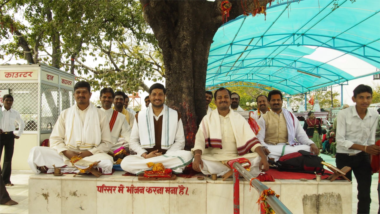 Pandits in Temple Grounds