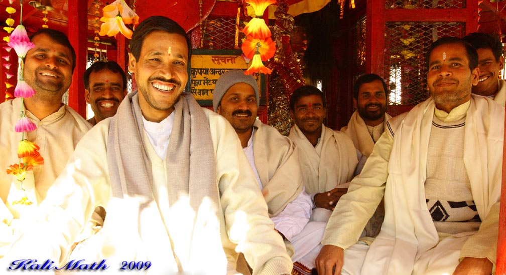 The pandits sit smiling in the temple. The photo was taken in 2009