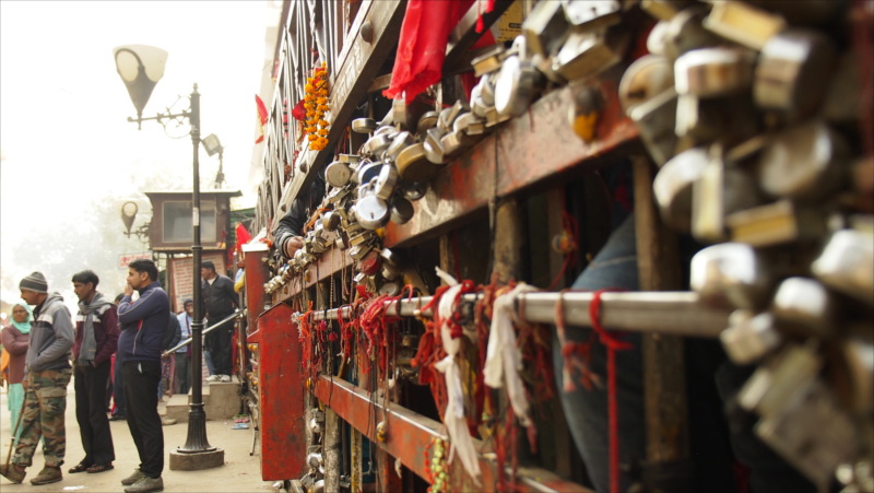 The front gate to the temple is weighed down by numerous locks, left there by passing pilgrims.