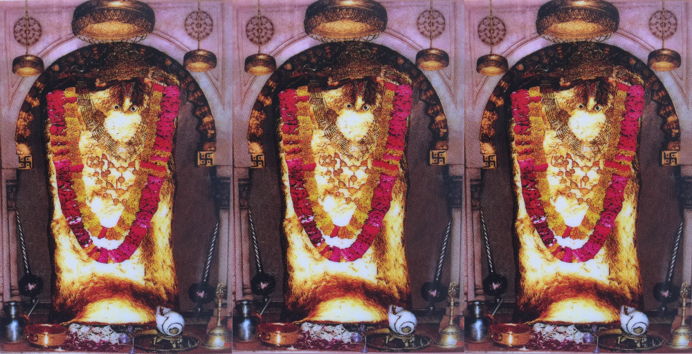 Three Identical Images of a rough-hewn stone-stature of hanuman; the monkey god.