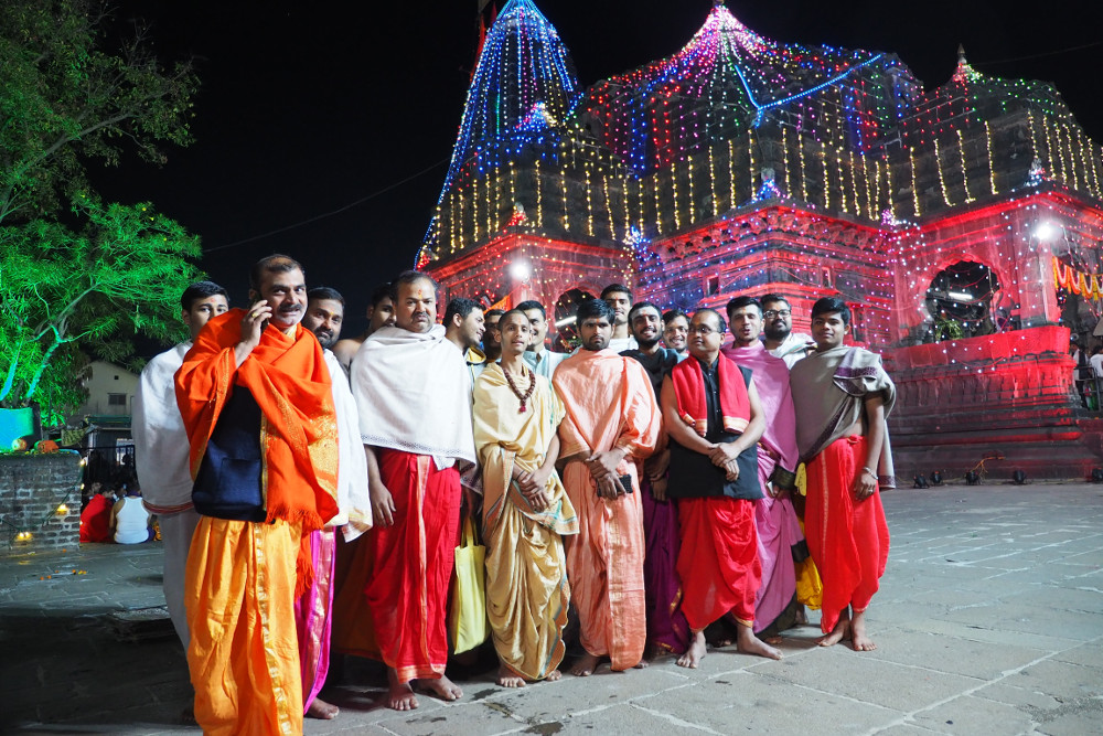 Temple Pandits posing together in front of Temple, post-ritual.