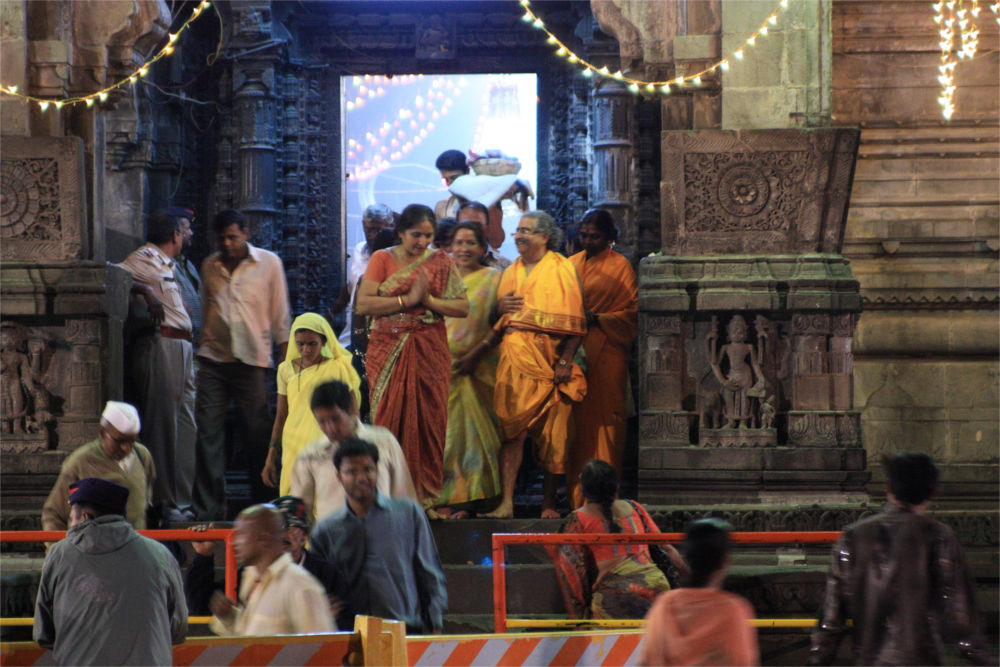 Pilgrims exiting the temple after recieving Darshan